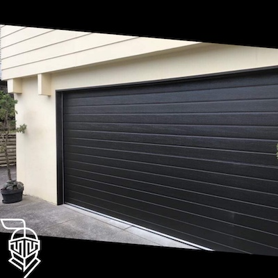 Garage doors repair for property manager - Auckland